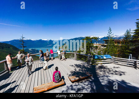 Tourists enjoying the view over Howe Sound from Sea to Sky Gondola, Squamish, British Columbia, Canada - Stock Photo