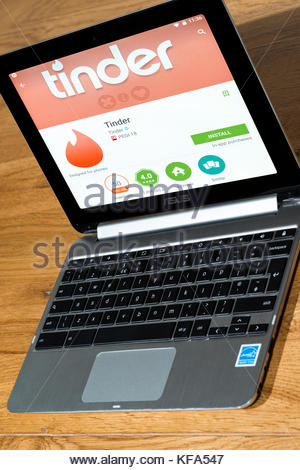 Tinder, dating app on a Chromebook, Dorset, England. - Stock Photo