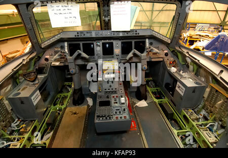 interior of the cockpit of the British Airways - CitiExpress Embraer ERJ-145 during maintenance in the hangar - Stock Photo