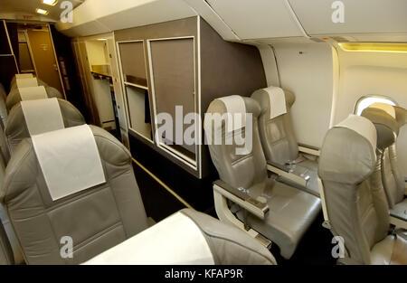 economy-class cabin seats on a Titan Airways BAE 146-200 QC - Stock Photo