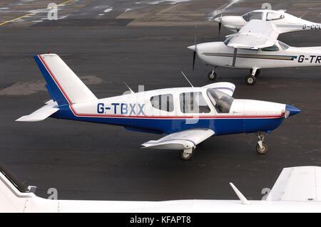 a SOCATA TB-20 Trinidad with Cessna 172M Skyhawk and Diamond DA40 Diamond Star TDI parked behind - Stock Photo
