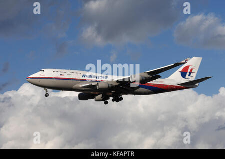 a Malaysia Airlines Boeing 747-400 on final-approach - Stock Photo