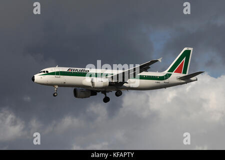 an Alitalia Airbus A320-200 on final-approach - Stock Photo