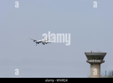 the air tower control-tower with the Breiting Super Connie, Switzerland Lockheed L-1049 Super Constellation C-121C - Stock Photo