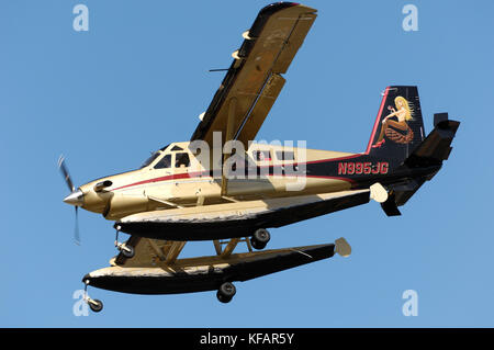 DHC-2 Turbo Beaver floatplane and special-livery tail-fin artwork on final-approach - Stock Photo