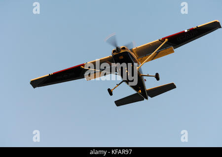 Cessna 172 Skyhawk On Final Approach With Landing Light On And Wing