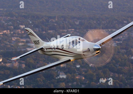Farnborough F1 Kestrel prototype flying over trees and houses - Stock Photo
