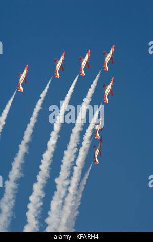 CASA C-101EB Aviojets of Spain - Air Force Patrulla Acrobatica Aguila flying in formation with smoke at Dubai AirShow - Stock Photo