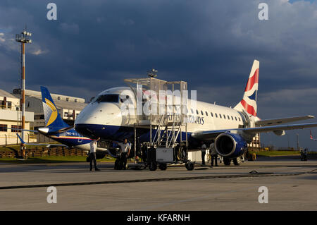 British Airways BA CityFlyer Embraer 170-100STD and tail-fin of JetBlue 190-200AR with 'mosaic' tail-fin special - Stock Photo