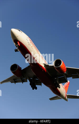 Air India Boeing 777-300ER flying on final-approach to Heathrow - Stock Photo