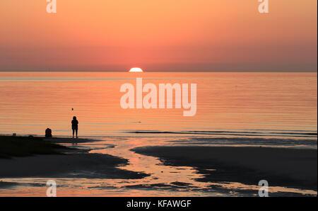 Sunset on Cape Cod Bay at Skaket Beach, Orleans, Massachusetts - Stock Photo