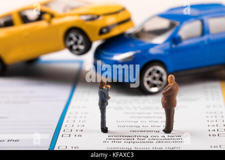 filling the car accident statement after crash concept - Stock Photo