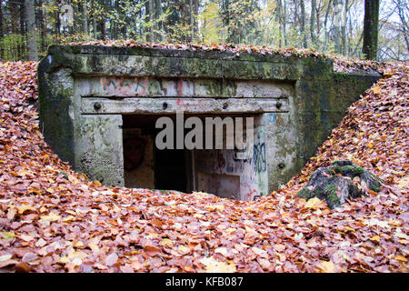 Old bunkers from World War II. German fortifications from the Pomeranian embankment. Autumn season - Stock Photo