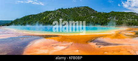 Terraces fan out from vivid colors of the Grand Prismatic Spring in Yellowstone National Park, Wyoming. - Stock Photo