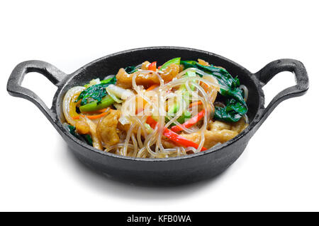Korean rice noodle with vegetables on frying pan - Stock Photo
