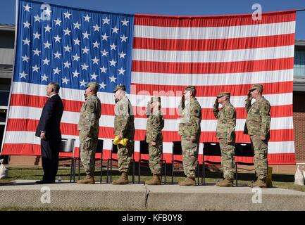 U.S. Louisiana Governor John Bel Edwards (left) stands in formation with U.S. soldiers during a deployment ceremony - Stock Photo