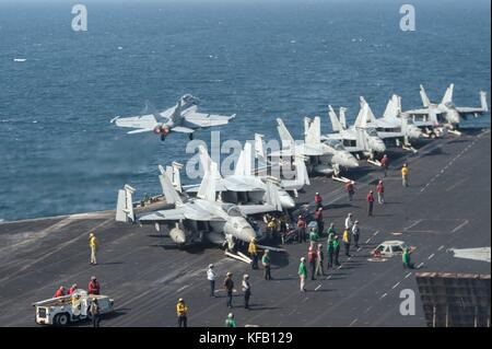 Aircraft take off the flight deck aboard the U.S. Navy Nimitz-class aircraft carrier USS Nimitz October 20, 2017 - Stock Photo