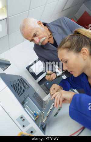 computer it support worker fixing machine in office - Stock Photo