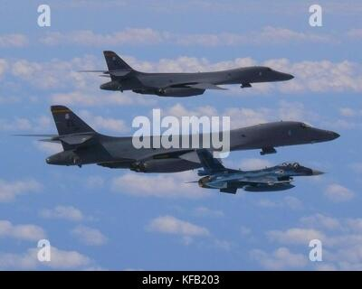 Two U.S. Air Force B-1B Lancer strategic bomber aircraft and a Japanese Air Self-Defense Force Koku Jieitai F-2 - Stock Photo