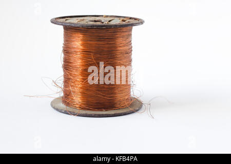 Copper wire on spool, isolated on white backgrounds, with clipping paths on white background - Stock Photo