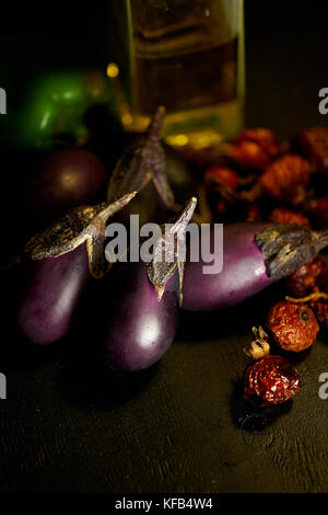 Eggplant, dried rosehip and olive oil.A pleasant lunch and harvest festival. - Stock Photo