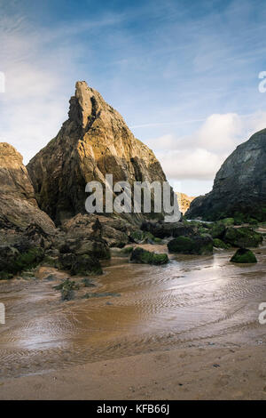 Holywell Bay in Cornwall - a stream running through rugged rocks at Holywell Bay in Newquay, Cornwall. - Stock Photo