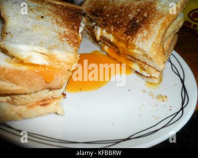 Toasted fried egg sandwich - Stock Photo