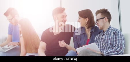 Group of young people in casual clothes chatting and having fun  - Stock Photo