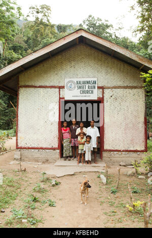 PHILIPPINES, Palawan, Barangay region, a Batak preacher and his family stand in front of the church that they built - Stock Photo