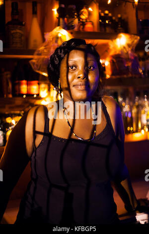 JAMAICA, Port Antonio. The bartender at the All Star Bar and Lounge. - Stock Photo