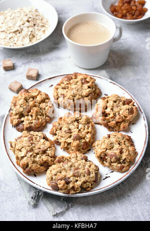 Breakfast with healthy oatmeal cookies and coffee - Stock Photo