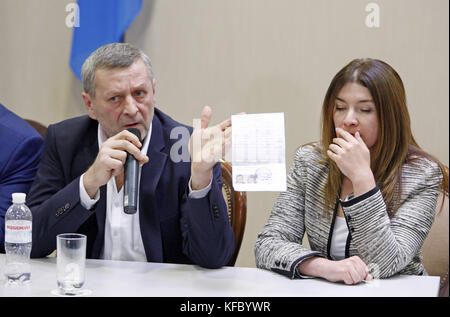 Kiev, Ukraine. 27th Oct, 2017. Elmira Ablyalimova (R) reacts while her husband Tartar activist AKHTEM CHIYGOZ (L) - Stock Photo