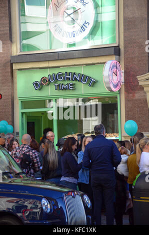 London, UK, 27/10/2017 Queues around the corner for free doughnuts to celebrate the opening of a new branch of Doughtnut - Stock Photo