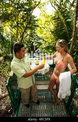 BELIZE, Punta Gorda, Toledo, guests can enjoy cocktails and complimentary snacks at Belcampo Belize Lodge and Jungle - Stock Photo