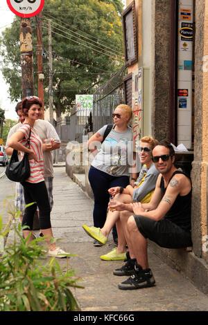 BRAZIL, Rio de Janiero, Santa Theresa, a group waits outside Bar do Mineiro at lunchtime - Stock Photo