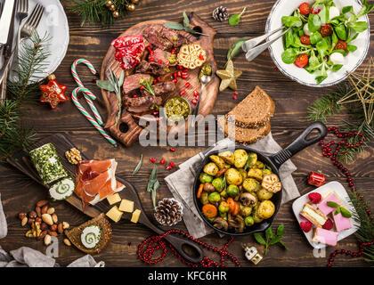Christmas themed dinner table - Stock Photo