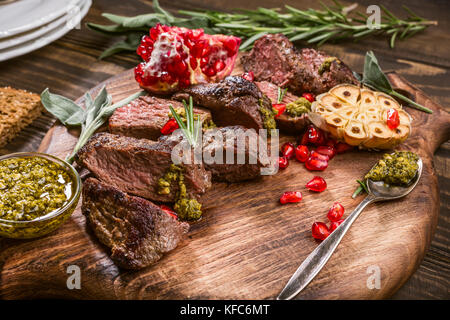 Meat steak with green pesto - Stock Photo