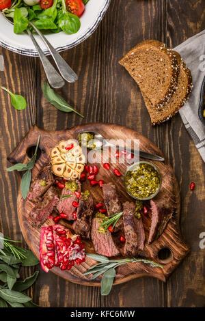 Meat steak with green pesto - Stock Photo