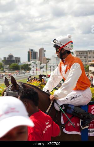 MAURITIUS; Port Louis; an international horse race draws thousands at Champ de Mars Race Cource; International Jockey - Stock Photo