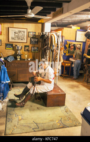 MEXICO, San Pancho, San Francisco, La Patrona Polo Club, one of the players in the tack room following the match - Stock Photo