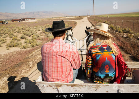 USA, Nevada, Wells, guests can participate in Horse-Drawn Wagon Rides during their stay at Mustang Monument, A sustainable - Stock Photo