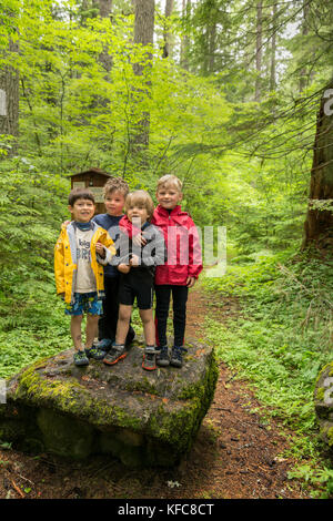 USA, Oregon, Santiam River, Brown Cannon, young boys pose for a photo in the Willamete National Forest before going - Stock Photo