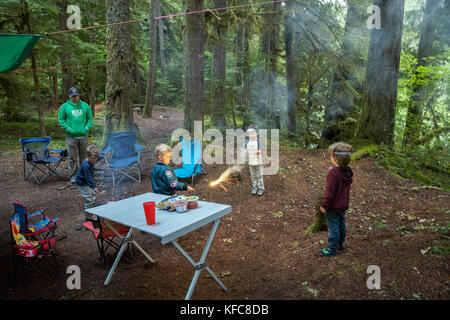 USA, Oregon, Santiam River, Brown Cannon, young boys playing in a campground near the Santiam River in the Willamete - Stock Photo