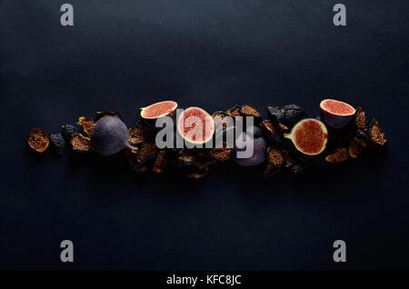 Close-up Picture of Fresh and dried Deep Blue Figs on a Dark Background. - Stock Photo