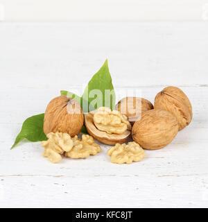 Walnuts walnut nuts square on wooden board food - Stock Photo