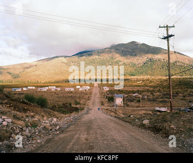 ARGENTINA, Patagonia, country road leading towards mountain against sky - Stock Photo