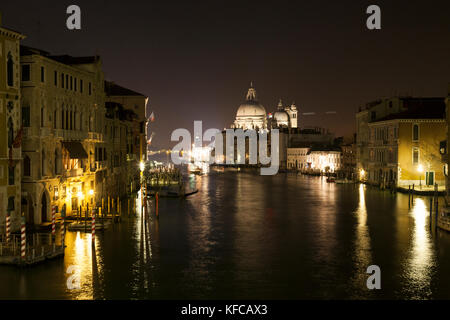 ITALY, Venice.  A view from Ponte dell' Accademia bridge of the Grand Canal at night. The domes of the Basilica - Stock Photo