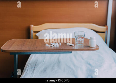 pills and thermometer on table - Stock Photo
