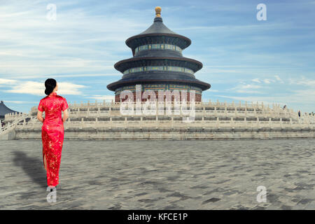 Asian young woman in old traditional Chinese dresses in the Temple of Heaven in Beijing, China. - Stock Photo