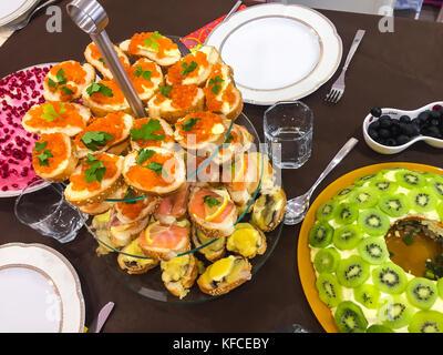 Bruschetta with caviar or salmon on  buffet table. Studio Photo - Stock Photo
